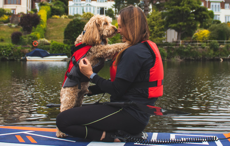 Reggie and Suzanne nose kisses paddle boarding on River Dee