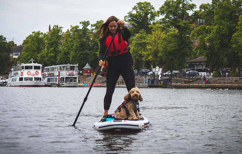 Reggie and Suzanne stand up paddleboarding